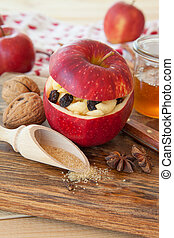 Preparing backed apples - Preparing baked apple with...