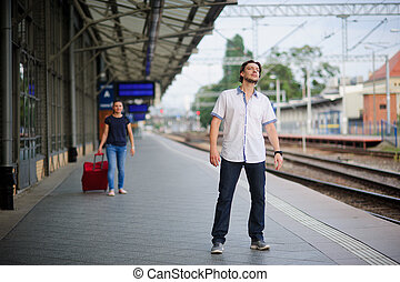 Young man on the platform waiting for someone He anxiously...
