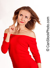 smiling woman in red posing against white background studio...