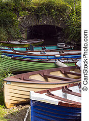 rowing boats moored at ross castle bridge - rowing boats...
