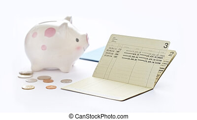 Saving account passbook, book bank and piggy bank on white...
