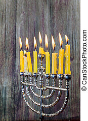 Chanukah candles all in a row. Bright, shiny the Jewish...