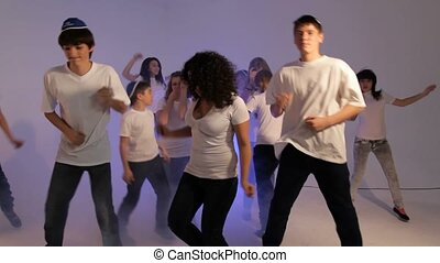 Disco Dancing Party - Group of teenagers dancing at the...