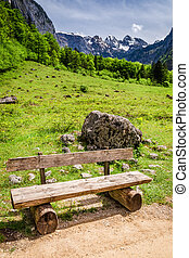The wooden bench at the Konigssee lake, Alps, Germany