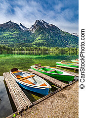 Colorful boats on the lake Hintersee in the Alps, Germany