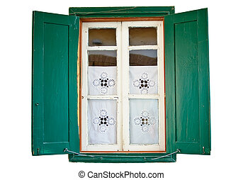Window with wooden painted green shutters on white