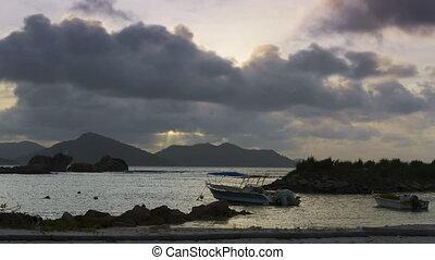 Time lapse of sunset at harbour of La Dique, Seychelles -...