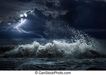 dark ocean storm with lgihting and waves at night - dark...