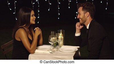 Romantic couple enjoying an evening dinner - Romantic sexy...