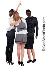 back view of three young business woman pointing.