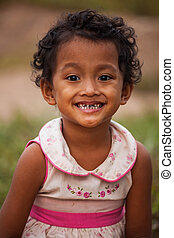 Portrait of smile asian poor girl in Thailand