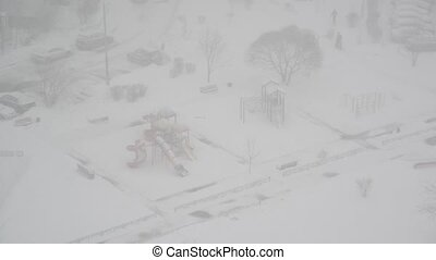 Top view of city and courtyard playground during a snowstorm...