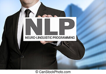 Nlp sign is held by businessman.