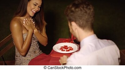 Romantic young man proposing to his love kneeling on the...