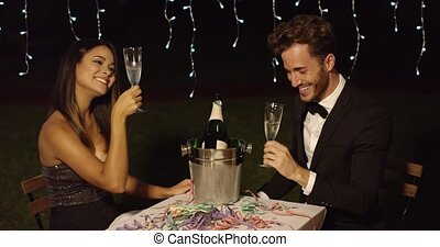 Happy New Year dinner celebration with a romantic elegant...