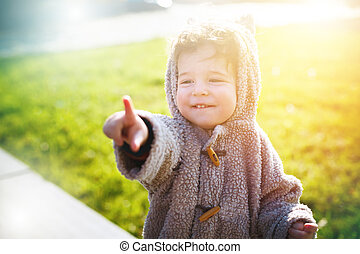 Cute little kid in funny clothes like teddy bear suite...