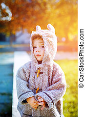 Cute little kid boy in funny clothes like teddy bear suite...