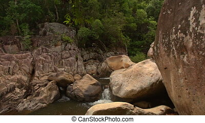 Large Boulders on Mountain River Cascade in Park - large...