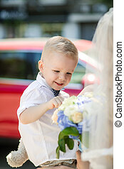 small child smelling the wedding bouquet