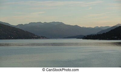 Sunset Time-Lapse of the Arona City, From Across the River in Italy