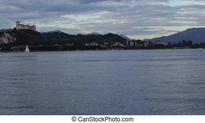 Sunset Time Lapse of the Arona City, From Across the River -...