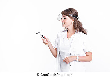 Doctor ENT is holding the Otoscope. Otolaryngologist in...