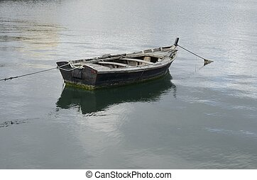Lonely fishing boat - Lonely fishing boat in the Ria of...