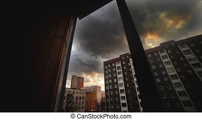 Day pass by in city. View from window of building. Grey clouds. Timelapse.