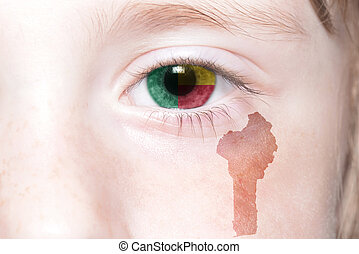 human's face with national flag and map of benin.