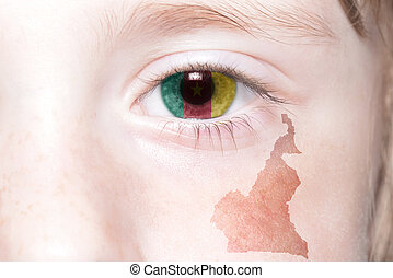 human's face with national flag and map of cameroon.