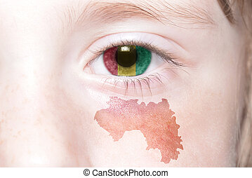 human's face with national flag and map of guinea.