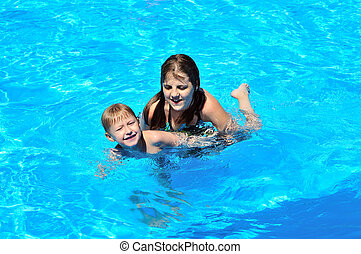 sister teaching brother to swim - sister teaching little...