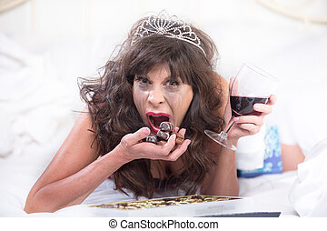 Upset Woman in Tiara Drinking Wine and Cramming Chocolates...