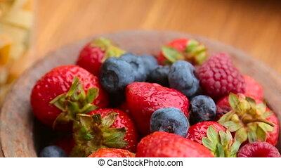 fresh berries , strawberries, raspberries, blueberries in a...