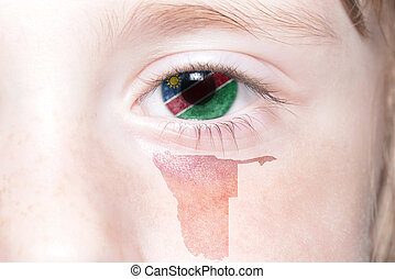 human's face with national flag and map of namibia. concept