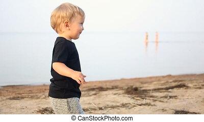 boy kid blonde running on the beach