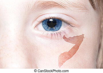 human's face with national flag and map of somalia. concept