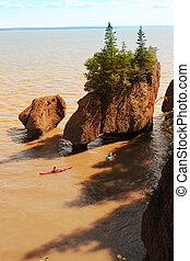 Kayakers at Hopewell Rocks in the Bay of Fundy, New...