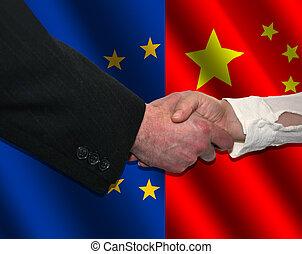 EU and Chinese handshake - handshake over EU and Chinese...