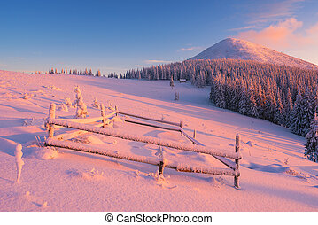 Winter dawn in the mountain village - Frosty morning in...