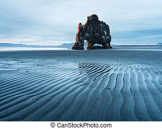 Hvitserkur rock - a tourist attraction in Iceland -...