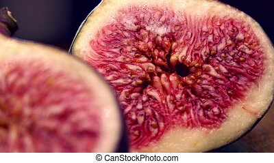Cut ripe figs 4K close up pan shot - Cut figs 4K closeup pan...