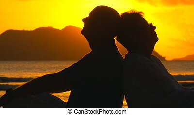 elderly couple at sunset closeup