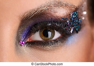 Eye makeup with colorful crystals. Close up