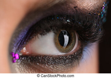 Smokey eye with colorful crystals. Close up