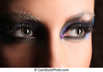 Girl's smokey eye with colorful crystals. Close up. Black background