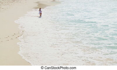 elderly couple walking along beach 001 part II - senior...