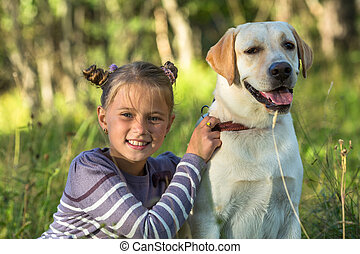 Happy little girl with her dog.