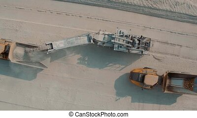 Loading a Large Truck in Limestone Quarry. Aerial shot in 4k
