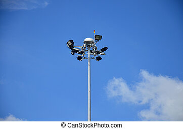 Spotlight pole at Trang airport on blue sky background